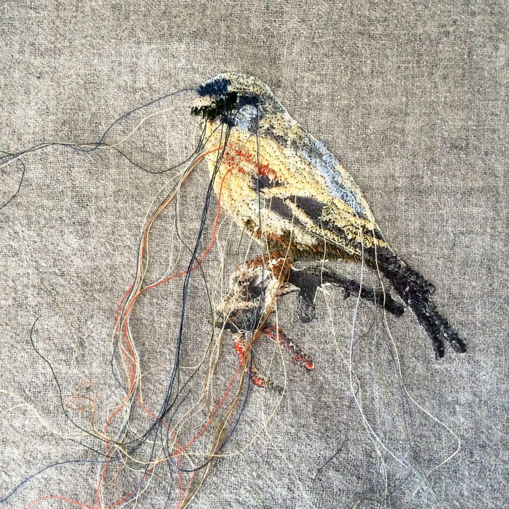 Vogel Blau gestickt